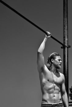 Charlie Hunnam(Jack Teller on S.O.A.). Between him and Joseph Gordon-Levitt....well let's just say I wouldn't mind being between the two of them :)