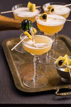 """10 Fancy Cocktails to Make With Champagne. pocked because of the """"bees knees"""" made with honey."""