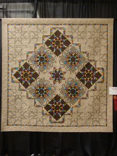 Amazing quilt! Go to the site to see the quilting -- It's worth the trip!
