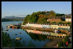 Portree Harbour, Isle of Skye, Scotland.  I've seen so many pictures of these colorful buildings, I want to see them in person!