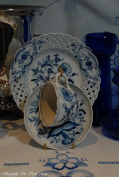 Blue Onion. Such a pretty plate in the back with the cutwork on it.  Blue and white is so clean and fresh looking.  Lovely display.
