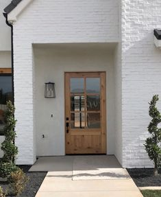 There is an exterior trend we've been loving--light wood entry doors.Today we have a beautiful roundup of light wood doors for every aesthetic to help inspire your own design. - May 30 2019 at Painted Exterior Doors, Painted Brick Exteriors, Wood Entry Doors, The Doors, Exterior Paint, Exterior Design, Exterior Shutters, Door Design, House Design