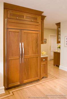 #Kitchen Idea of the Day: Natural & light wood kitchens gallery. (By Crown Point Cabinetry). Charming, light wood panelized refrigerator
