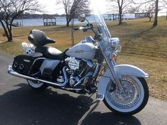Beautiful 2013 Harley-Davidson Road King.  That backrest is a Tourrest. It keeps Mama happy, but when Mama isn't riding I can remove it in seconds, so I am happy too!