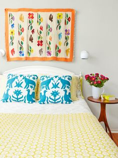 As pretty as art but less expected, a Mexican-style wool rug makes a colorful statement in this #bedroom. #HGTVMagazine http://www.hgtv.com/design/decorating/design-101/a-house-with-lots-of-style-on-a-little-budget-pictures?soc=pinterest