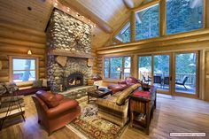 I -love- the windows in this room and the fireplace... I am a huge fan of log cabins and this is beautiful and cozy.