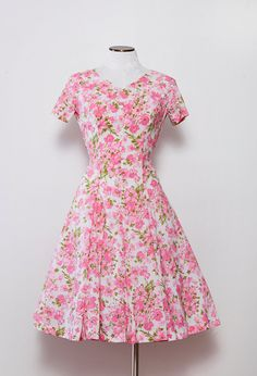 1950s Vintage Pink Dress.  I love the fashion from the 1950's.  Dress it up with blue or green gemstones.