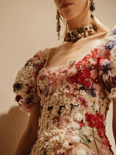 A 3D floral dress with hand-embroidered wild island flowers - SS17 AlexanderMcQueen
