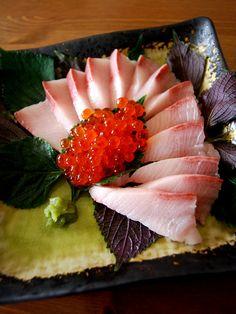 Hamachi sashimi with shiso and ikur
