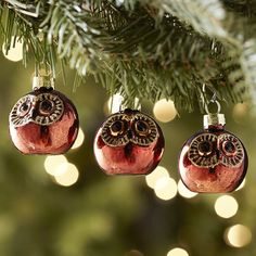 A set of bronze-colored owls adds a bit of holiday shine to the Natural Noel look. #Christmas #ornaments