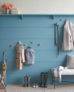 DIY entryway decor- wooden hangers (actually, drawer knobs painted different colors) look modern and fresh, not childish, and their rounded edges make them safe for little noggins walking nearby.Hanger bolts are threaded at both ends, and you'll need them to connect the knob to the wall. To find the correct size, take the screw that comes with the knob to a hardware store and ask for a match.