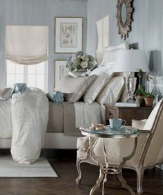 Romance. Soft blue and white. Everything but the sunburst frame over the bed.