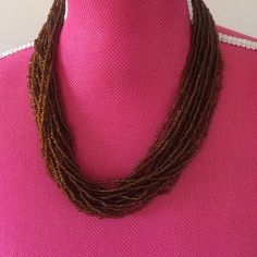 Brown beaded necklace This necklace looks so nice on Jewelry Necklaces