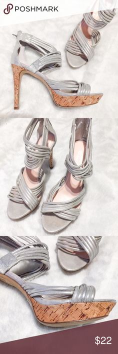 Gianni Bini Silver Ankle Strap Heels Sz 8 Gorgeous metallic silver heels by Gianni Bini! Straps of subtlety stretchy silver straps  and bits of metallic glitter in the cork heels add the sassy zest GB is great at! Ankle strap adds another fashion edge. I have worn these a couple of times and they are In EUC. ENJOY! Heels are 4.25 Gianni Bini Shoes Heels