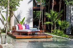 A daybed suspended over the pool at Mi Amor, Tulum.