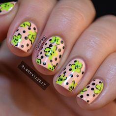 Peachy neon Floral Nails
