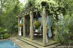 hmmm.... outdoor curtains in our pergola and hot tub maybe