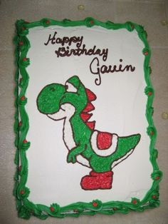 My middle son's 9th birthday cake. Yoshi from Super Mario and Yoshi game. Buttercream icing drawn directly on the cake.