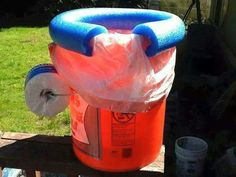 Camping toilet DIY bucket with pool noodle seat and toilet roll holder