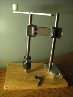 Hand Tapper by Amy Qian -- Homemade hand tapper constructed from case-hardened shafting, aluminum bar stock, flange bushings, shaft collar, steel tubing, a drill chuck, and plywood. http://www.homemadetools.net/homemade-hand-tapper-6