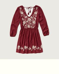 A pretty peasant dress in easy woven fabric, featuring a figure-flattering cinched waist, V neckline, cinched sleeves, tassel ties at back and white floral embroidery details, Classic Fit, Imported