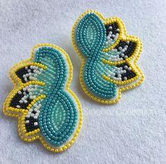 Beaded infinity earrings by Ana Sinohui