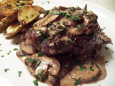 Beef Tenderloin with Mushroom Brandy Cream Sauce & Roasted Truffled Fingerling Potatoes.....seriously....I may not be able to wait for dinner, this might have to be breakfast!!!!