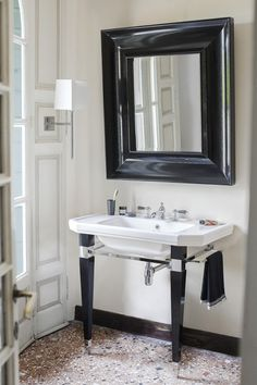 Claremont Déco black console, Claremont ceramic console basin.Black Sky mirror. Glasgow wall lamp with fabric shade.