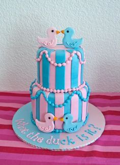 Gender Reveal pink and blue cake. What the duck is it? Haha so witty and cute!!!