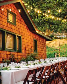 At Claire and Benjamin's rustic, outdoor reception, clear and frosted lights are strung along the house, which was once Clark Gable's hunting lodge.
