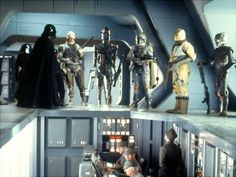 The bounty hunters assemble aboard the Executor's bridge, to the dismay of Piett and the crew.