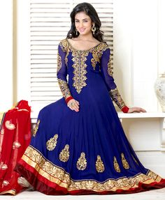 Outfit is a novel ways of getting yourself noticed.   The dazzling dark blue faux georgette anarkali churidar suit have amazing embroidery patch work is done with resham, zari, stone and lace work.   Beautiful embroidery work on kameez is stunning.   The entire ensemble makes an excellent wear.   Matching santoon churidar and red faux chiffon dupatta is available with this suit.   Slight Color variations are possible due to differing screen and photograph resolutions.