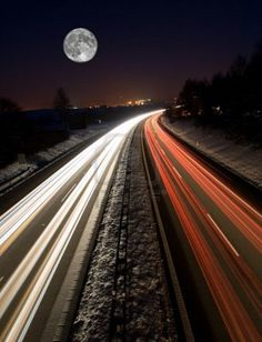 Highway traffic in the night with full moon Stock Photo