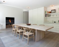 beautiful minimal kitchen_white and blonde wood dining table_wishbone chairs
