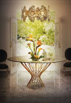 In this picture you can see a dark lobby or waiting room with a luxurious wood material table that gives a romantic and exotic vibe to the room. Ideal to give some feminine touch to a big house and to fill up the place the only thing that's missing it's a chandelier to give the room that high end touch.
