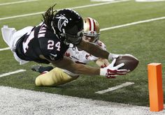 Atlanta Falcons RB Devonta Freeman never gives it less than all he's got, always reaching for the goal line. (AP/Bazemore)