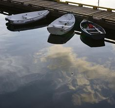 Three dinghies seem to float above the clouds at the marina in Ganges on Salt Spring Island.