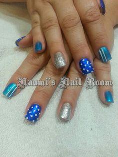 Blue polka dot striped nail art by Naomi