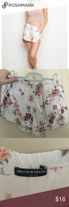 Brandy Melville Flower Flowy Shorts white and pastel flower flowy shorts // worn only once // no rips or stains // one size fits all Brandy Melville Shorts