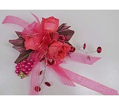 Prom corsage with vivid pink sweetheart roses, hot pink faux rhinestone strands, Aspidistra Leaf ribbon, sheer pink ribbon on a keepsake butterfly bracelet