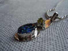 A faceted citrene and a dichroic glass in silver pendant
