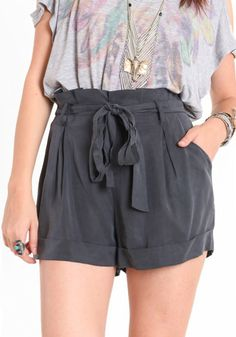 Cute and comfortable faded black paperbag shorts with a matching fabric belt at waist. Pockets on either side. Decorative pockets on back.