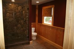 rustic stone tile bathrooms | This rustic woodsy feeling bathroom was designed to accommodate the ...