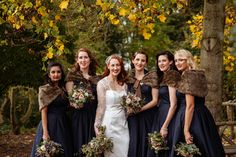 Photography by Toast of Leeds Navy bridesmaids dresses with dark brown fur