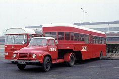 British European Airways C519, 953ALR, was a Bedford J4A2 tractor unit coupled to a B.T.C. Semi-trailer chassis with a Samlesbury B24C (originally B44C) body new in 1961. These had centre entrances on both sides. It was one of twenty such vehicles used for airport terminal transfer work at London Airport and was non-P.S.V. Next to it is one of the ten Marshall bodied Bedford VAL14s new in 1967 which were used in a similar manner.