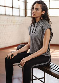 Work out in style: black active pants with grey side stripe paired with a sleeveless hoodie