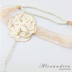 Alexandria Head Band  http://www.brittenweddings.co.uk/shopbritten/hair-combs/product-alexandria-silk-rose-vintage-lace-ivory-pearl-bridal-wedding-headband/