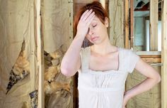Frustrated woman during home renovation - Steven Errico/Getty Images