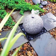 Have a small space? Make a big impact with a compact water feature. A recirculating fountain made from a stone sphere, slate chips, and stone pavers is an elegant yet easy-to-create addition suitable to any outdoor living area.