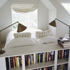 "The bed is placed to look outside (which, for what I can see, is a relaxing view), the ""headboard"" divides the room and hold the book collection."